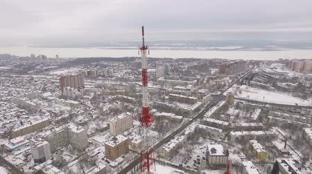 cellular structure : aerial panorama of snowy city, camera is showing a tv tower