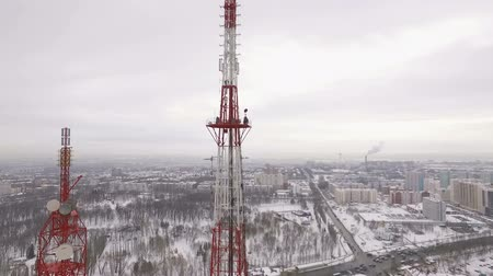 truss : drone is moving to a site of telecom tower when workers are performing repair