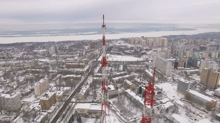 cellular structure : high panorama of modern city and teletower in winter day, buildings Stock Footage