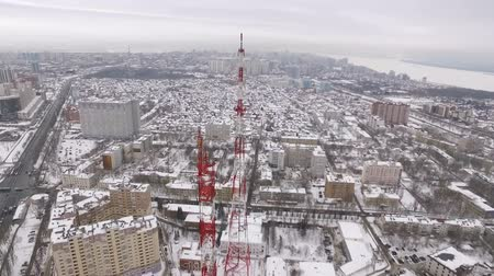 cellular structure : around aerial flying shot of tv tower in winter day, Samara city