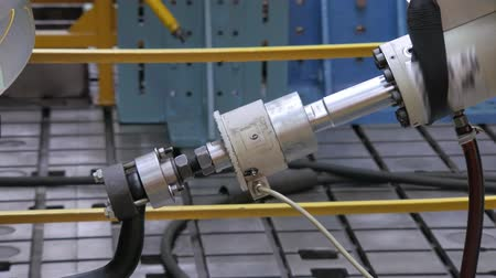 bracket : close-up of piston of robotic machine is immitating a car trailer in movement ,bench tests