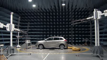 pyramidal : new automobile is standing in anechoic chamber for testing on a car plant, transmitters