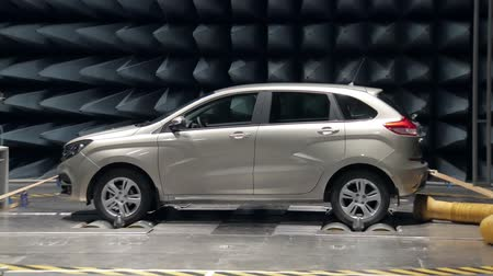 absorption : new automobile is standing in anechoic chamber for testing on car plant, walls covered by absorbers Stock Footage