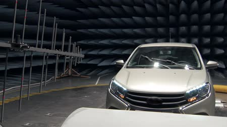 pyramidal : transmitter is emitting waves on working automobile in anechoic test chamber