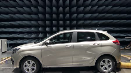 radiation : automobile during testing of electromagnetic compatibility in radio-frequency anechoic chambers Stock Footage