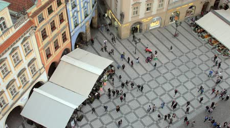red square : people are walking in front of Prague astronomical clock, top view from tower