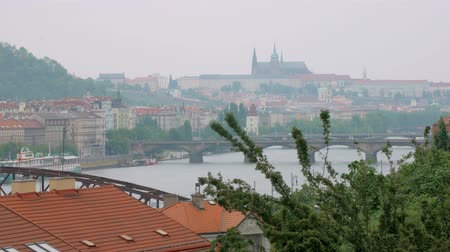 shores : city landscape in Prague in summer day in cloudy weather, view on river