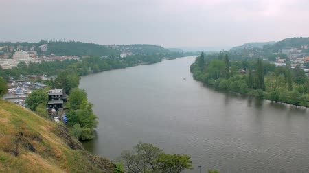 shores : top view on wide european river and outskirts of old city in cloudy weather
