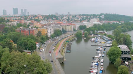 shores : aerial view of Prague with residential districts and small river mooring