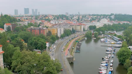 shores : horizontal panorama of outskirts of Prague city in cloudy weather, tram and cars Stock Footage