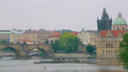 shores : calm landscape in Prague city in spring cloudy day, Vltava river, Charles bridge