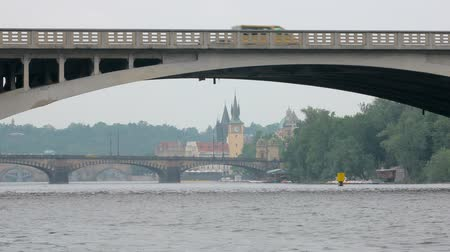 shores : bridges on Vltava river and old towers of Prague Stock Footage