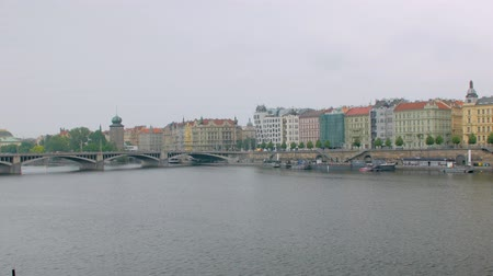 shores : amazing view of shore of Prague with quay of Vltava river, bright buildings, view from other coast