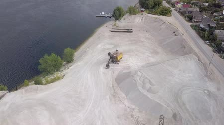 taş ocağı : top view from drone on a quarry of limestone with excavator , in sunny day Stok Video