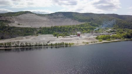 vários : aerial view on area of mining and processing limestone, quarry in a rock near river Stock Footage