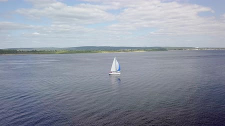 hajózik : aerial view of white sailboat on river, camera is flying around
