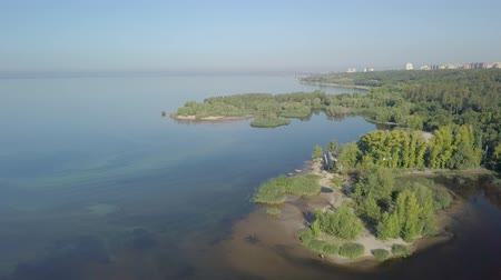 aerial view on calm landscape with lakes, river, city panorama in background Стоковые видеозаписи