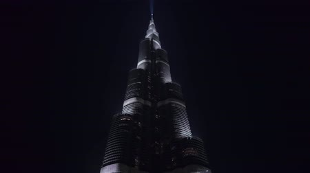 khalifa : DUBAI, U.A.E. - JAN, 2018: static view on Burj Khalifa tower in night in background of dark sky