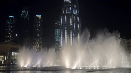 spraying : DUBAI, U.A.E. - JAN, 2018: water streams of amazing show of large fountains in night time, wonderful performance