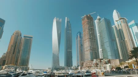 modern yacht mooring pier in Dubai Marina and skyscrapers in sunny day