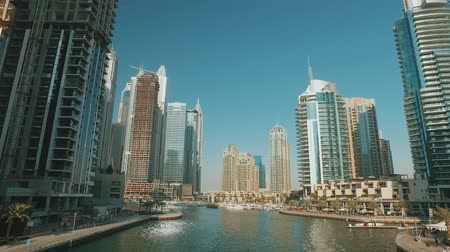 view on beautiful modern buildings in Dubai Marina in sunny day