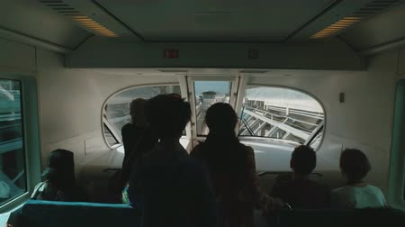 tourists are riding in wagon of monorail in Dubai palma in sunny day Стоковые видеозаписи