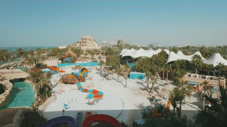 waterslide : waterpark in Dubai in summer day, attractions and amusements, people are resting