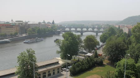 cityscape of Prague in sunny summer day, old buildings and river Стоковые видеозаписи