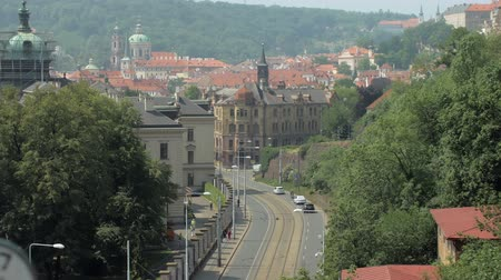 amazing cityscape in Prague in spring day, cars are moving on road Стоковые видеозаписи