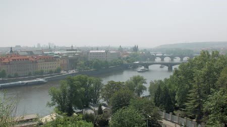 wonderful landscape of Prague in sunny summer day, old buildings and river Стоковые видеозаписи