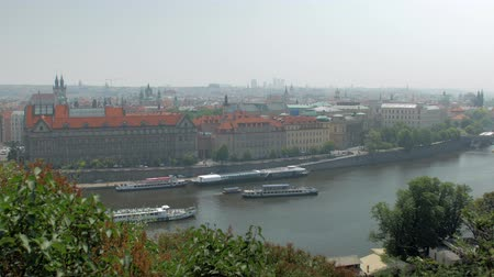 pleasure boats are floating over Vltava river in Prague city in summer day
