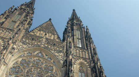 ikonszerű : tilt up panoramic view from ancient gothic church St Vitus cathedral to blue sky in Prague