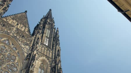 amazing frontal view and panorama of ancient gothic church St Vitus cathedral to blue sky Стоковые видеозаписи