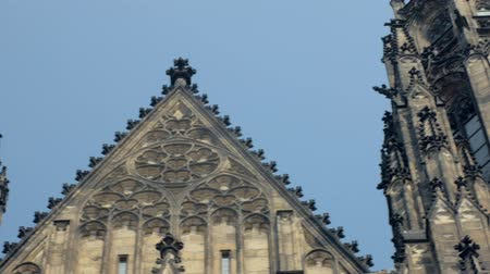 figures and decorations on facade and towers of old gothic cathedral Стоковые видеозаписи