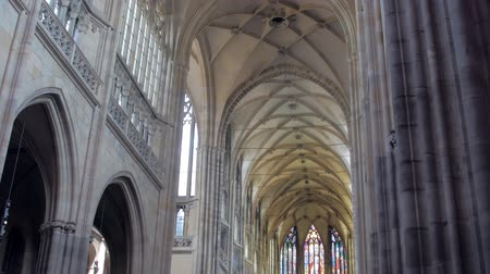 panoramic view on picturesque gallery inside gothic cathedral, columns