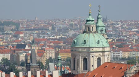 čeština : wonderful city view on Prague city with red roofs and domes of churches