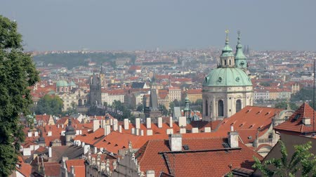 Богемия : panoramic top view on Prague city with red roofs and domes of churches