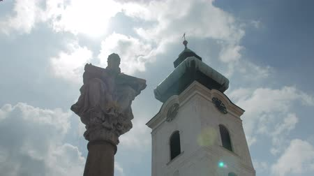 культ : ancient european architecture, picturesque tilt up view on tower and statue of Christ Стоковые видеозаписи