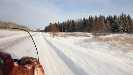 Snowmobile is off-road in the taiga
