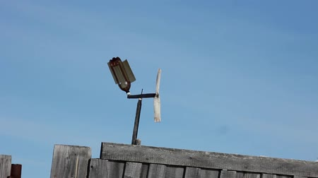 Weather vane flugel blows the wind in the village