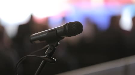 подиум : The microphone is on the stage of the conference