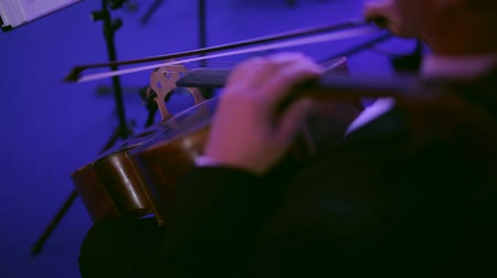 musician plays the cello on the stage in the concert hall