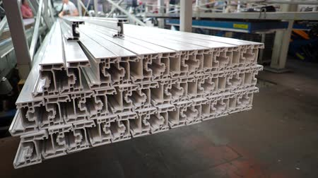 ayarlama : Shelf with profile blanks for the production of plastic windows. Components of PVC windows. Production of plastic windows. Factory for PVC windows and doors production.