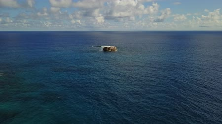 praslin : Lonely beautiful rock in the middle of Indian ocean near Seychelles drone shot 4K Footage Stock Footage