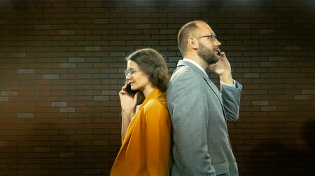 discar : Man and woman are talking on the phone 02 Stock Footage