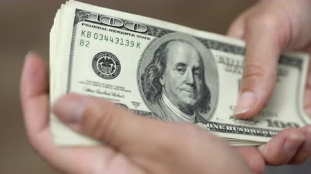 us banknotes : Hands counting dollars Stock Footage