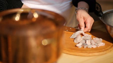 local : slicing fish on a wooden cutting board with a knife Stock Footage