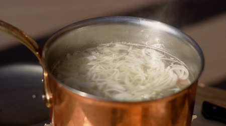 induction cooker : noodles boiling in a saucepan, noodle soup