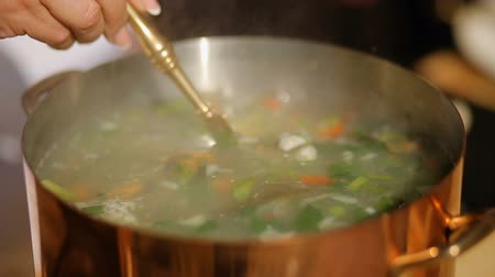 panelas : adding fish to fish soup. Cooking process. close-up Stock Footage