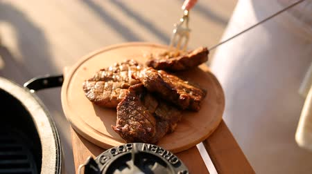lombo de vaca : roasted steak on a wooden board, close-up Stock Footage